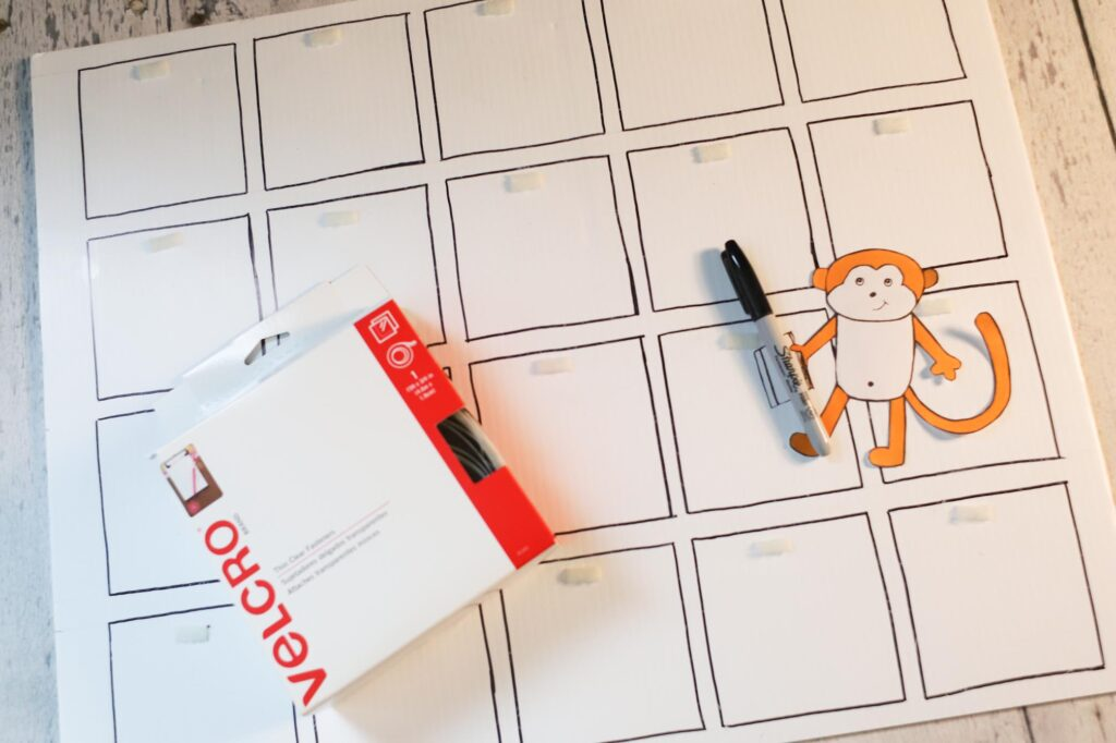 Story time board square outlines, permanent marker and velcro.