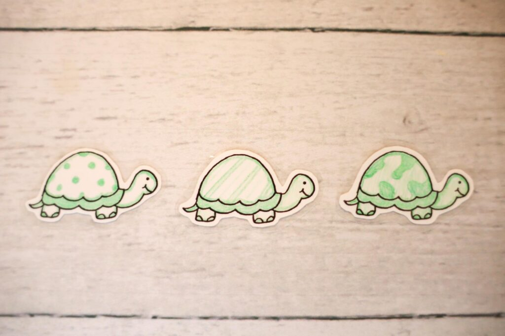 Three green turtles with patterned shells to use as song time buddies.