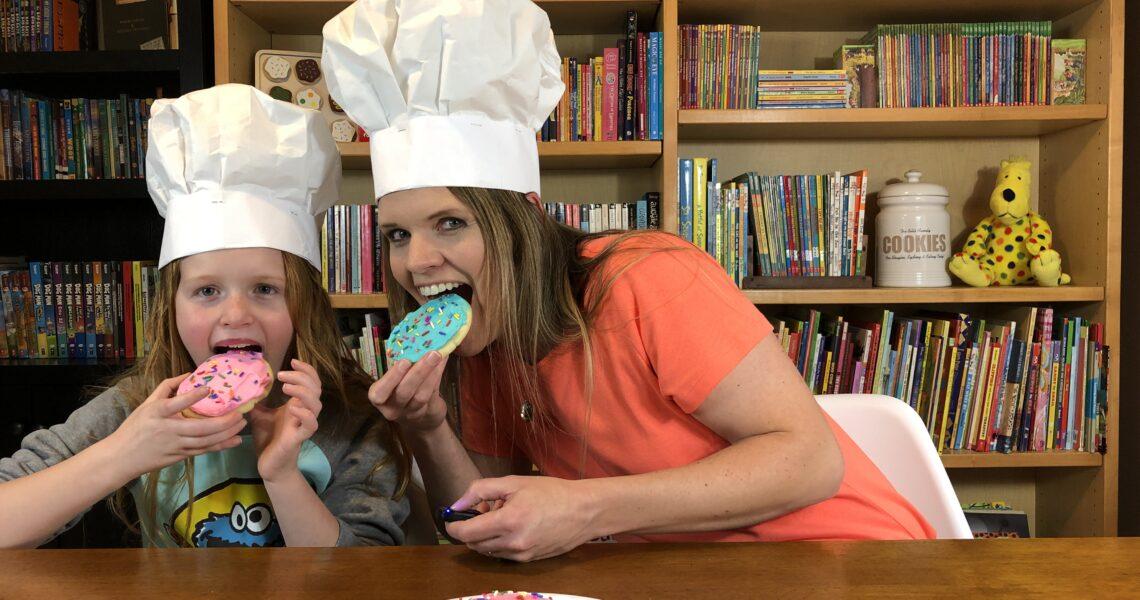 Jamie Bills and Kelsey Bills Eating Cookies in a Library