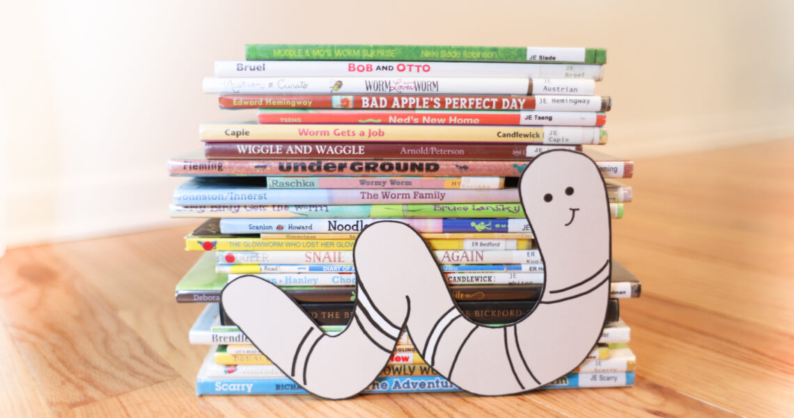 Worm Clipart in front of picture books about worms