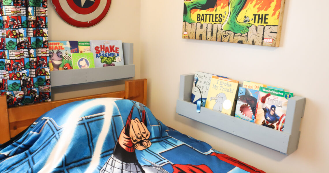 Book holders with picture books next to bed.