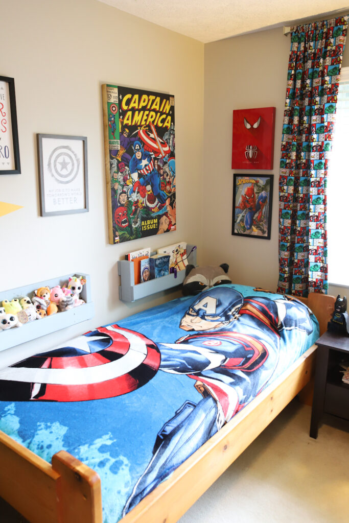 Bedroom with Avengers decor. Two wooden pallet book shelves attached to the wall.