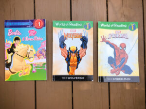 Step into reading Barbie Book and Two Marvel World of Reading Books.