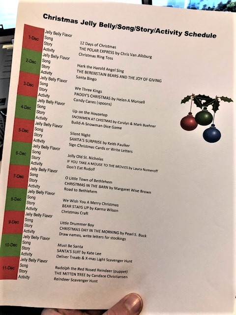 Typed schedule for story, song and activity ideas for Christmas time.